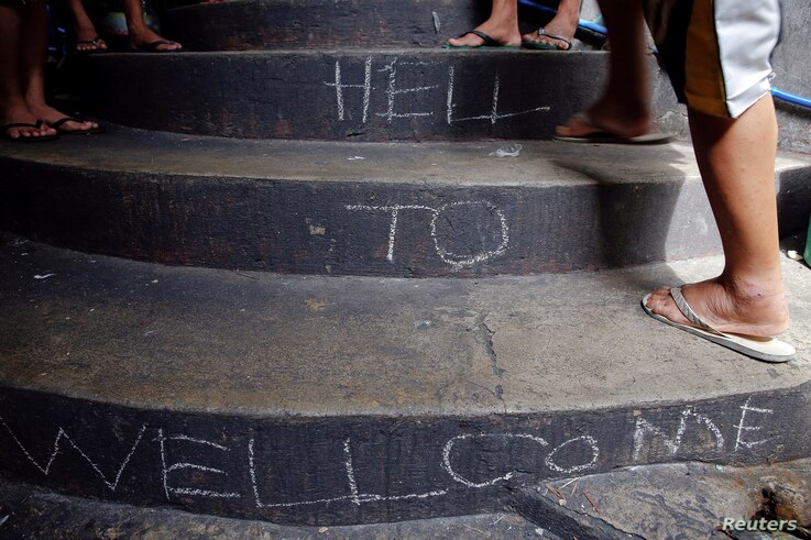 """FILE - """"Welcome to Hell"""" is written on the stairs inside Quezon City Jail in Manila, Philippines Oct. 19, 2016."""
