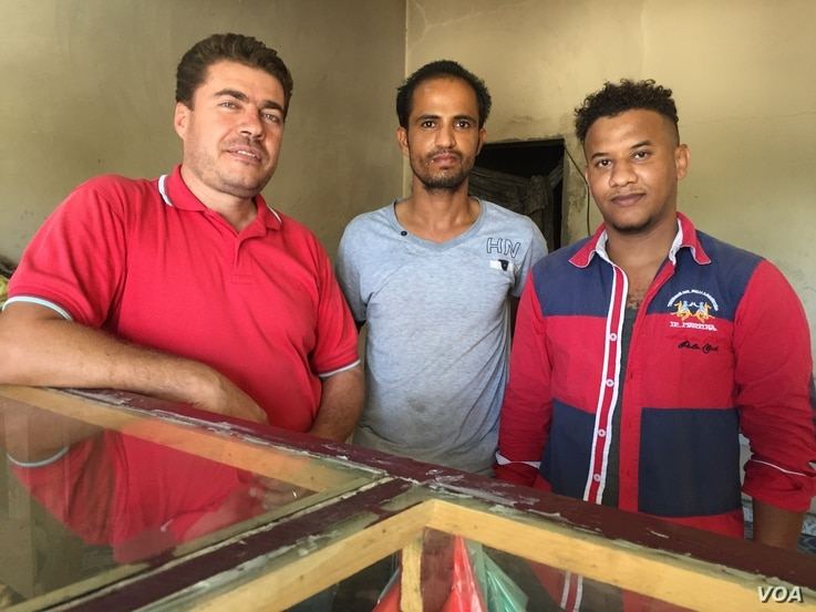 Syrian refugee and bakery owner Abdulrahman Darswish is shown with two Yemeni refugee workers at his bakery in Hargeisa, Somaliland, March 30, 2016.