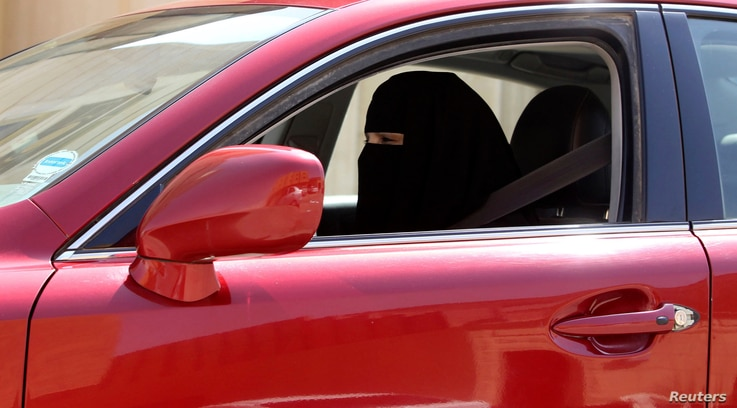 A woman drives a car in Saudi Arabia October 22, 2013. A conservative Saudi Arabian cleric has said women who drive risk damaging their ovaries and bearing children with clinical problems, countering activists who are trying to end the Islamic kingdo...