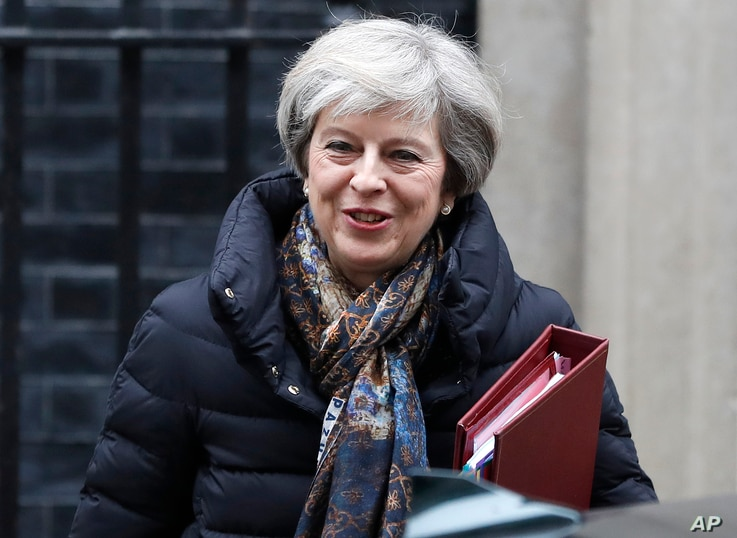 Britain's Prime Minister Theresa May leaves 10 Downing Street to attend parliament in London, Jan. 25, 2017.