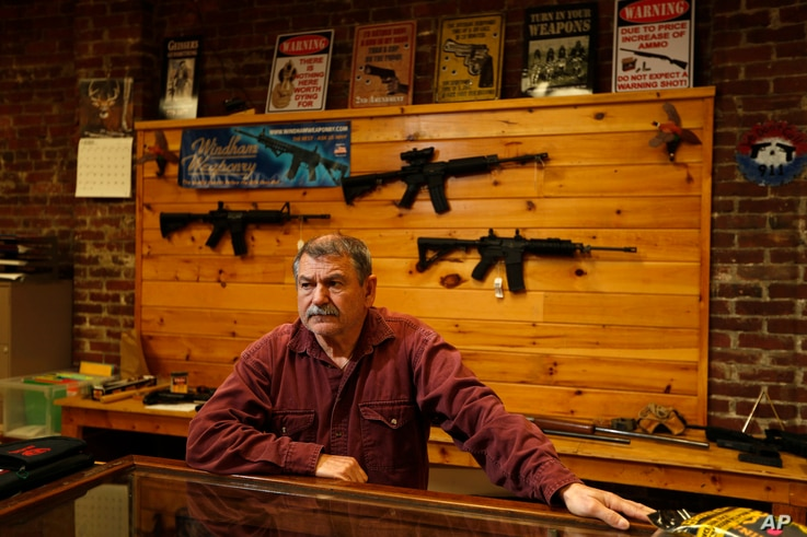 FILE - Bob Hagopian works in his gun shop in downtown Madison, Maine, Oct. 20, 2016. A gun background check ballot initiative in on the state ballot this year.