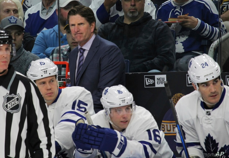 Toronto Maple Leafs coach Mike Babcock looks on during the first period of an NHL hockey game against the Buffalo Sabres, April 3, 2017, in Buffalo, New York.