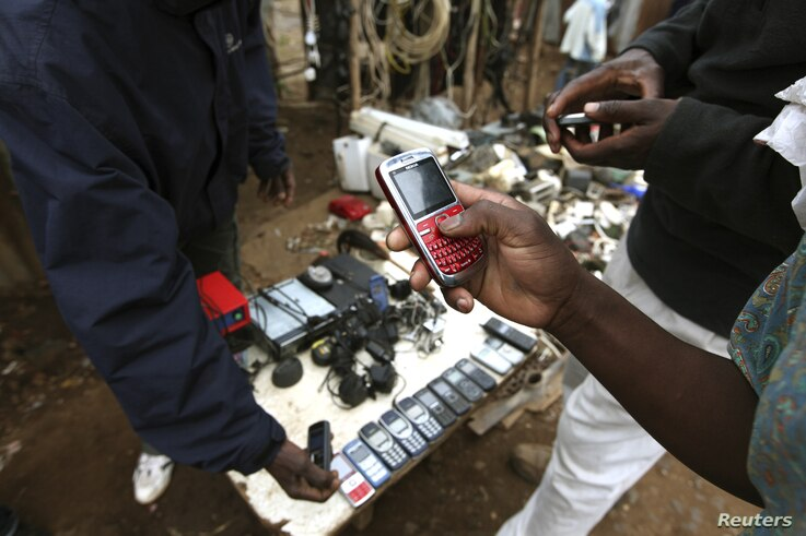 A vendor hawks second-hand mobile phones at the sprawling Kibera slum, one of the largest and poorest slums in Africa, near Kenya's capital Nairobi, August 26, 2011.