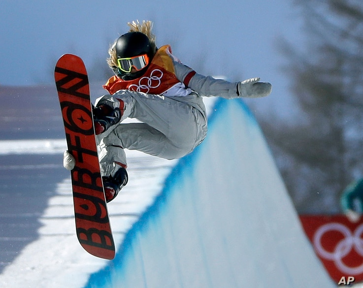 Chloe Kim, of the United States, jumps during the women's halfpipe finals at Phoenix Snow Park at the 2018 Winter Olympics in Pyeongchang, South Korea, Feb. 13, 2018.