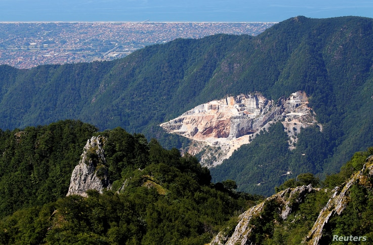A view of a marble quarry and the coast of Versilia from the Monte Altissimo in the Apuan Alps, Tuscany, Italy, July 18, 2017.