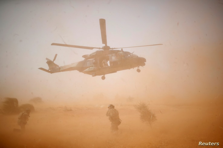 FILE - A NH 90 Caiman military helicopter takes-off during the regional anti-insurgent Operation Barkhane in Inaloglog, Mali.