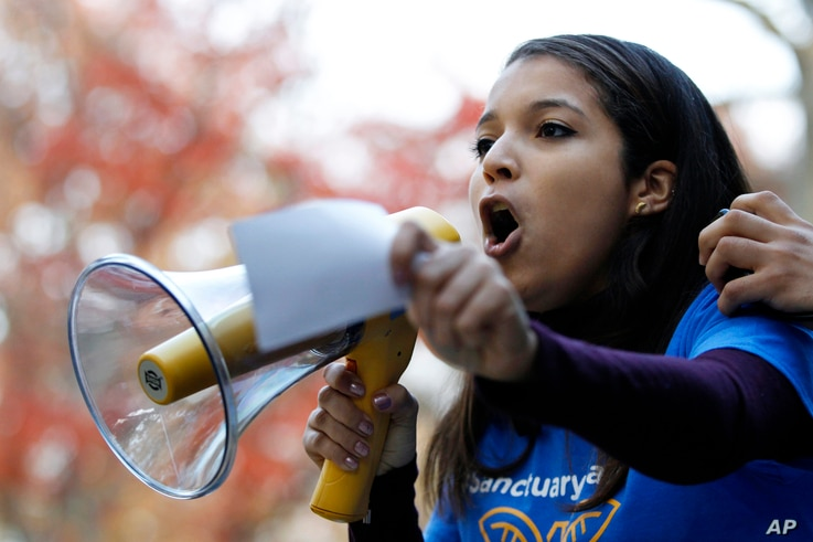 Rutgers University junior Carimer Andujar, of the Dominican Republic, shouts to a large crowd gathered to protest some of President-elect Donald Trump policies and to ask school officials to denounce his plans at Rutgers University, Nov. 15, 2016, i...