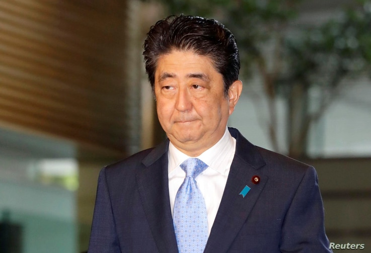 Japan's Prime Minister Shinzo Abe arrives at his official residence in Tokyo, Japan, in this photo taken by Kyodo, May 14, 2017, after South Korea's military said that North Korean had fired an unidentified projectile from a region near its west coas