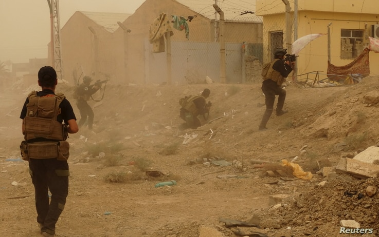 FILE - Iraqi security forces defend their headquarters against attacks by Islamic State extremists in the eastern part of Ramadi in Anbar province, May 14, 2015.