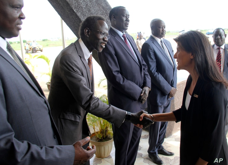FILE - US Ambassador to the United Nations Nikki Haley, right, meets South Sudanese officials on her arrival in Juba, South Sudan, Oct. 25, 2017. The ambassador, on a three-country Africa visit, met earlier with President Salva Kiir over the country'...