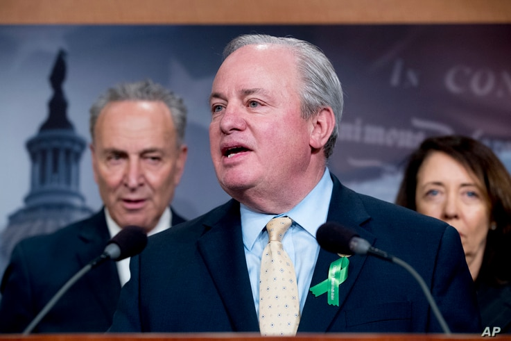Rep. Mike Doyle, D-Pa., center, accompanied by Senate Minority Leader Sen. Chuck Schumer of N.Y., left, and Sen. Maria Cantwell, D-Wash., speaks at a news conference about net neutrality in Washington,  May 16, 2018.