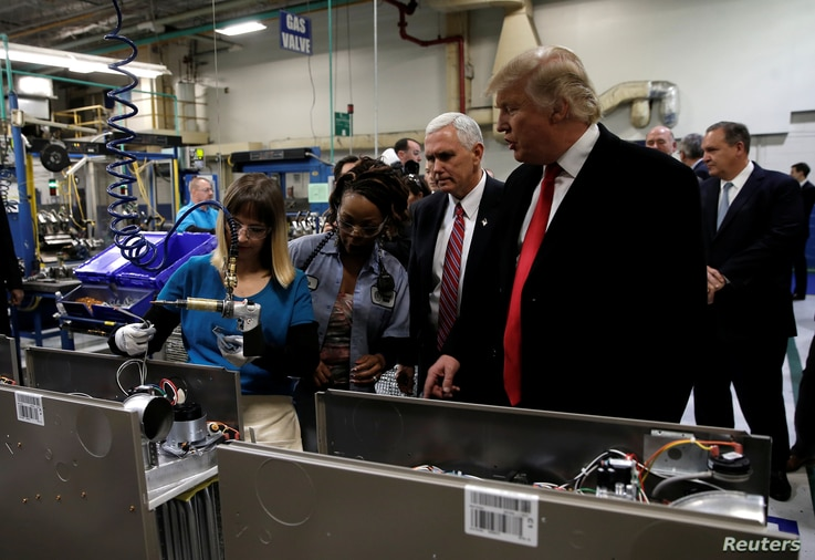President-elect Donald Trump tours a Carrier factory with Vice President-elect Mike Pence in Indianapolis, Indiana, Dec. 1, 2016.