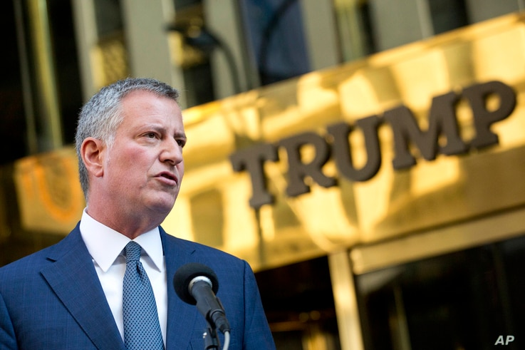 FILE -New York Mayor Bill de Blasio holds a news conference in front of Trump Tower following a meeting with President-elect Donald Trump, Nov. 16, 2016, in New York.