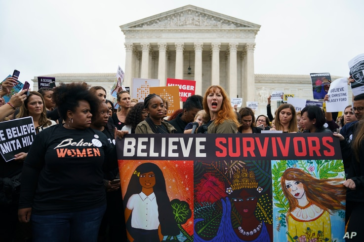 Protesters with Women's March and others gather in front of the Supreme Court on Capitol Hill in Washington, Sept. 24, 2018.