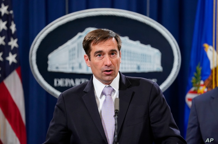 Assistant Attorney General for National Security John Demers speaks during a news conference to announce a criminal law enforcement action involving China, at the Department of Justice in Washington, Nov. 1, 2018.