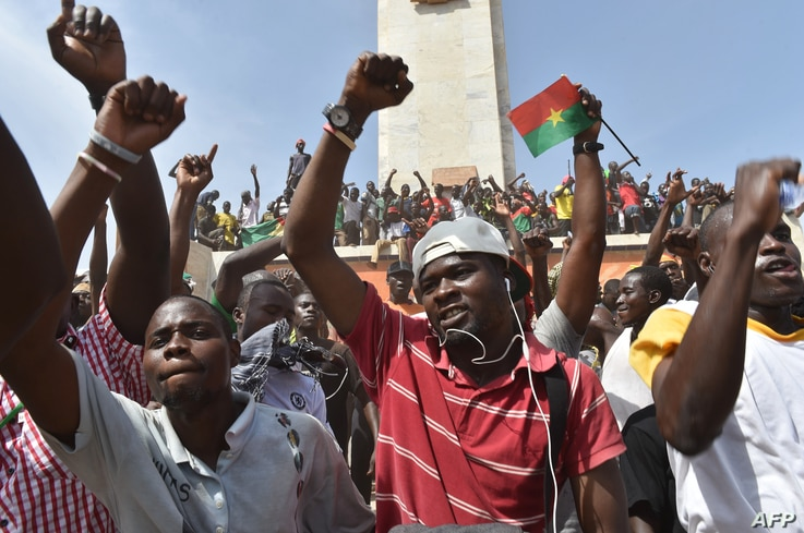 People celebrate in the capital Ouagadougou after Burkina Faso's embattled President Blaise Compaore announced he was stepping down, Oct. 31, 2014.