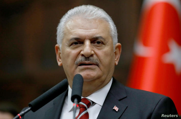 Prime Minister Binali Yildirim addresses members of parliament at the Turkish parliament in Ankara, Nov. 8, 2016.