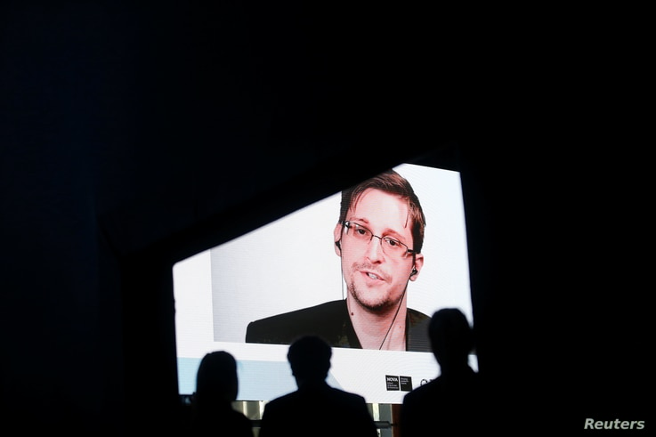 Edward Snowden speaks via video link during the Estoril Conferences - Global Challenges, Local Answers in Estoril, Portugal, May 30, 2017.
