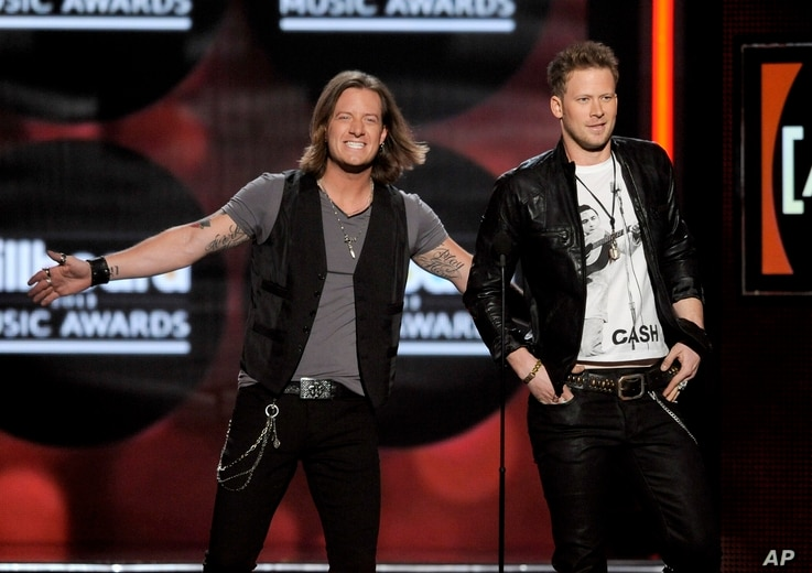 Tyler Hubbard, left, and Brian Kelley, of Florida Georgia Line, on stage at the Billboard Music Awards at the MGM Grand Garden Arena in Las Vegas, May 19, 2013.