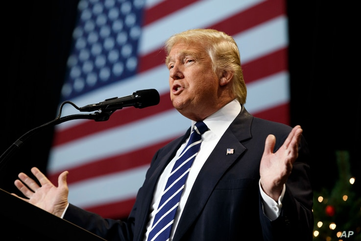 President-elect Donald Trump speaks during a rally at the Wisconsin State Fair Exposition Center in West Allis, Wisconsin, Dec. 13, 2016. In what is seen as a voting ritual, the Electoral College on Monday is expected to officially confirm Trump as t