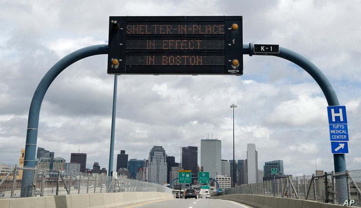 """A sign calling for citizens of Boston to """"Shelter in Place"""" is shown on I-93 in Boston, Friday, April 19, 2013."""