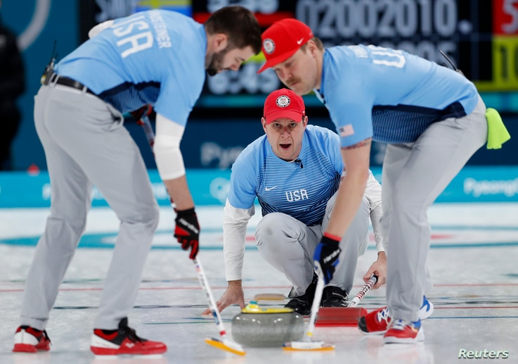 Skip John Shuster of the U.S. watches the shot as his teammates, lead John Landsteiner and second Matt Hamilton, sweep.The team won the first gold medal for curling in U.S history, Feb. 24, 2018, in Gangneung, South Korea.