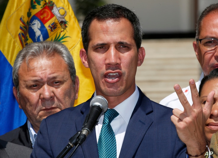 Opposition leader Juan Guaido, who has declared himself the interim president of Venezuela, speaks during a press conference on the steps of the National Assembly in Caracas, Venezuela, Monday, Feb. 4, 2019.