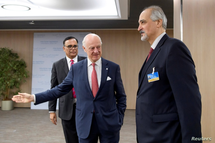 The United Nations Special Envoy for Syria, Staffan de Mistura (C) welcomes Bashar al-Jaafari, Syrian U.N. Ambassador, prior to a round of negotiations during the Intra Syria talks, at the European headquarters of the United Nations in Geneva, Switze...