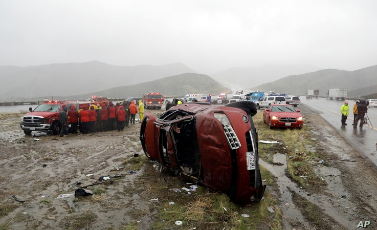 An overturned vehicle at a scene of a fatal accident, where a volunteer member of the Ventura County search and rescue team was killed, along Interstate Highway 5 south of Pyramid Lake, Calif., Feb. 2, 2019.