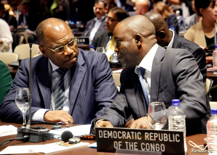 FILE - Democratic Republic of Congo's Parliament delegators Maitre Mbuku (R) and Leonard Okitundu talk together during the 128th Assembly of the Inter-Parliamentary Union (IPU) and Related Meetings in Quito March 23, 2013.