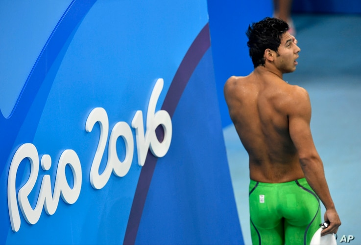 Rami Anis, swimming for the Refugee Olympic Team, leaves the hall after a men's 100-meter freestyle heat during the swimming competitions at the 2016 Summer Olympics, Aug. 9, 2016, in Rio de Janeiro, Brazil.