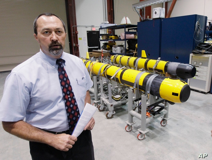 FILE - A pair of unmanned underwater vehicles (UUV) are pictured in a lab at the Naval Undersea War Center in Middletown, R.I.