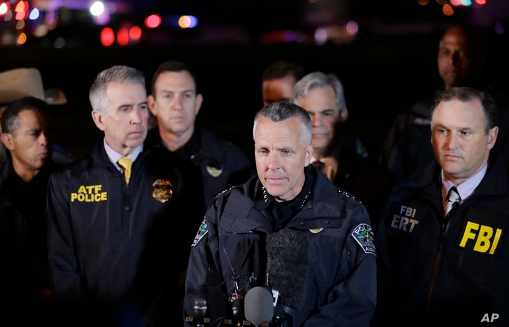 Austin Police Chief Brian Manley, center, stands with other members of law enforcement as he briefs the media,  March 21, 2018, in the Austin suburb of Round Rock, Texas.