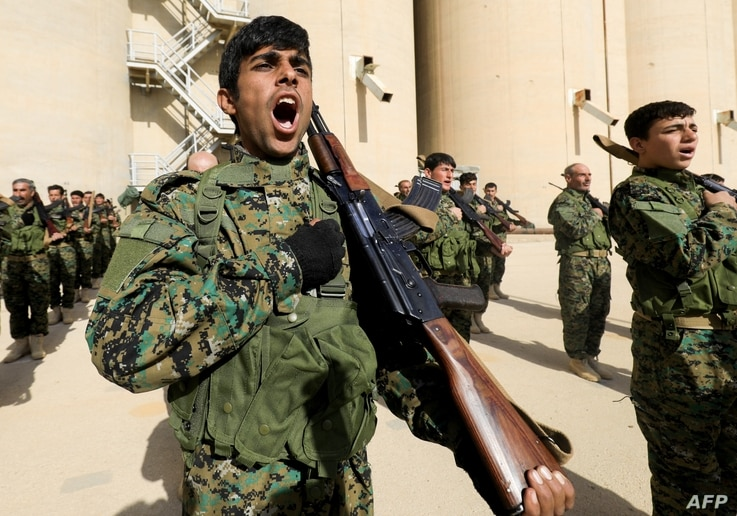 Syrian fighters attend their graduation ceremony near Syria's northeastern city of Hasakah, Jan. 20, 2018.