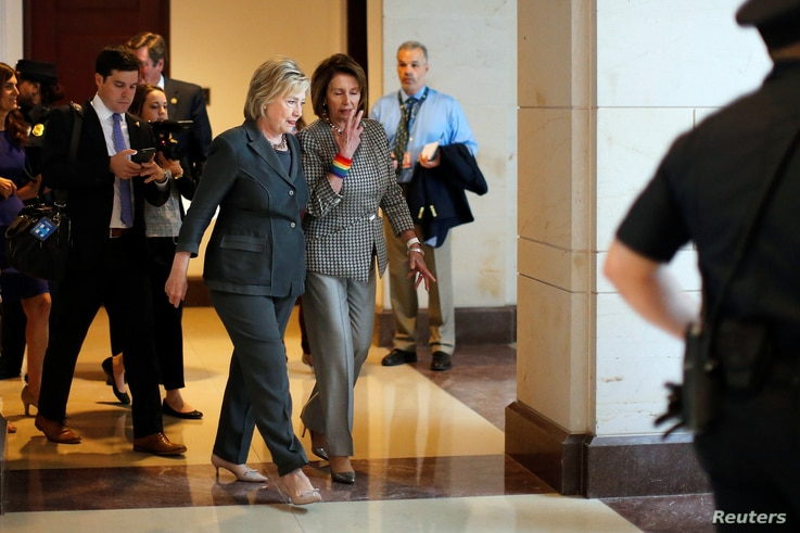 Democratic U.S. presidential candidate Hillary Clinton, left, and House Minority Leader Nancy Pelosi, a California Democrat, leave a House Democratic Caucus meeting on Capitol Hill in Washington, June 22, 2016.