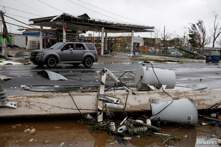 Damaged electrical installations are seen after the area was hit by Hurricane Maria en Guayama, Puerto Rico September 20, 2017.