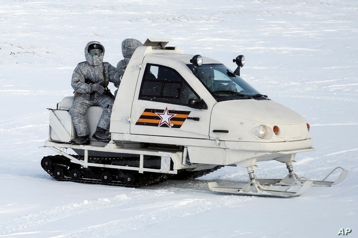 In this photo taken on April 3, 2019, a Russian military snowmobile travels across Kotelny Island, part of the New Siberian Islands archipelago located between the Laptev Sea and the East Siberian Sea, Russia.