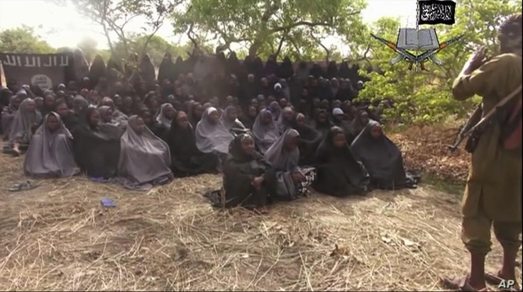 """FILE - This file photo taken from video by Nigeria's Boko Haram terrorist network, Monday, May 12, 2014, shows the missing girls alleged to be abducted April 14, from the northeastern town of Chibok. A Nigerian government official said """"all options a..."""