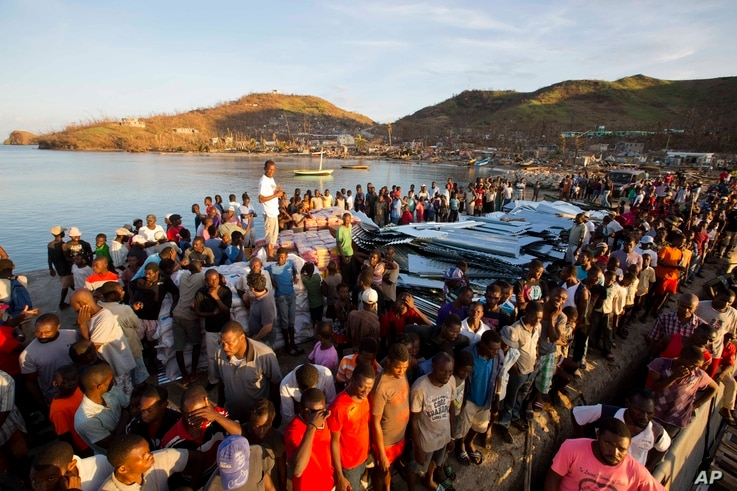 Residents line up for food after Hurricane Matthew in Anse D'Hainault, Haiti, Oct. 11, 2016.