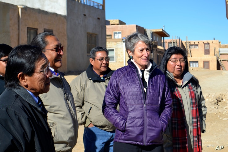 FILE - U.S. Interior Secretary Sally Jewell, second from right, tours Acoma Pueblo, a nearly thousand-year-old village that's situated atop a New Mexico mesa, with tribal leaders on Thursday, Dec. 8, 2016.