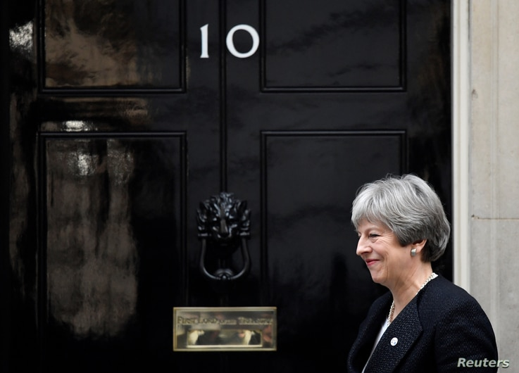 Britain's Prime Minister Theresa May walks out of 10 Downing Street in London, Jan. 30, 2018.