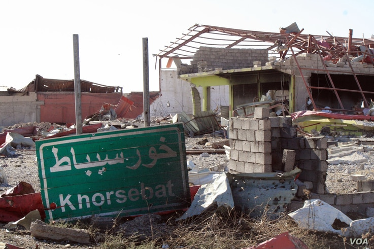 Khorsebat (or Khorsebad) is a village in ruins about 10 kilometers from Mosul.  The only business in the area are two men selling olives and olive oil on Nov. 23, 2016 in Khorsebad, Iraq. (H.Murdock/VOA)