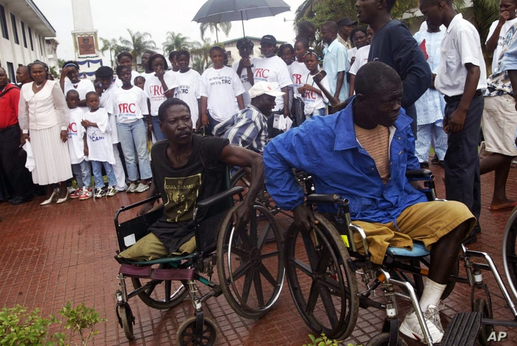 Two war victims seen in wheelchairs at the launch of Liberia's Truth and Reconciliation Commission in Monrovia, June 22, 2006. An  accounting of atrocities committed during nearly a quarter-century was aimed at setting the stage for a long-term peace...