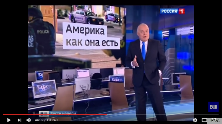 In this YouTube screen grab, Dmitry Kiselyov discusses the recent police shooting in Dallas on his weekly news review program Vesti Nedeli on Moscow Rossiya TV, July 10, 2016.