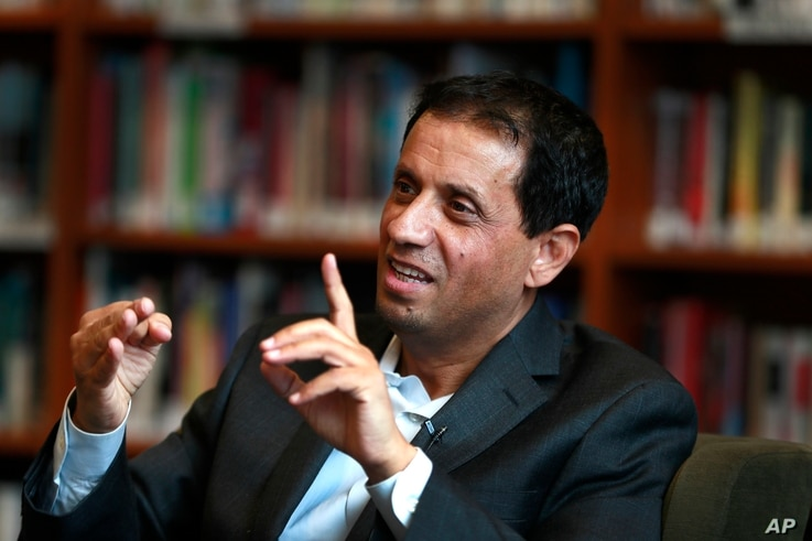 Rasheed Alnozili, publisher of The Yemeni American News, is interviewed in Dearborn, Michigan, Jan. 9, 2018. People from Yemen have recently begun to see long-term futures in the U.S. and are making their culture part of their businesses.