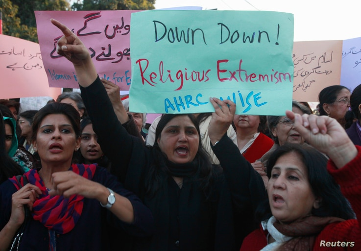 FILE - Women chant slogans condemning Islamist terrorism during an anti-terror rally in Lahore, Pakistan, Jan. 16, 2015.