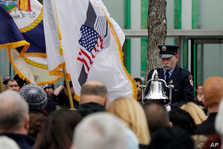 Firefighter James Sorokac, of the Fire Dept. of New York Ceremonial Unit, rings a bell marking the time of the 1993 World Trade Center, during the 25th anniversary ceremony at the 9/11 Memorial to commemorate the six victims, in New York, Feb. 26, 20...