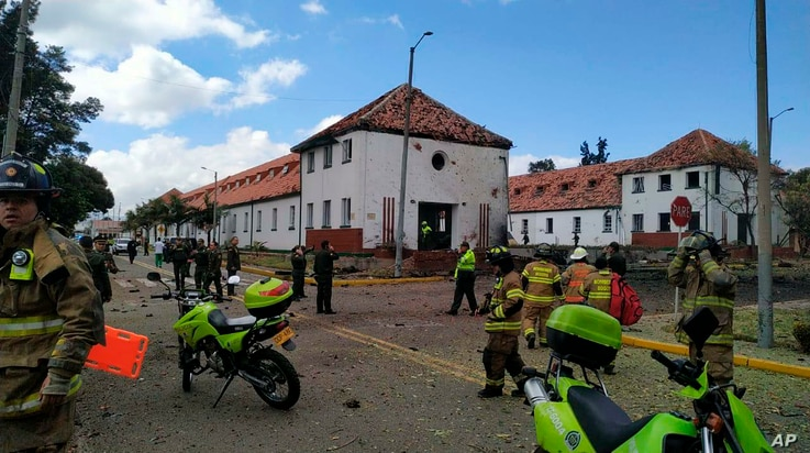 In this image provided by military personnel, emergency personnel respond to the scene of a deadly car bombing at a police academy, Jan. 17, 2019, in Bogota, Colombia.