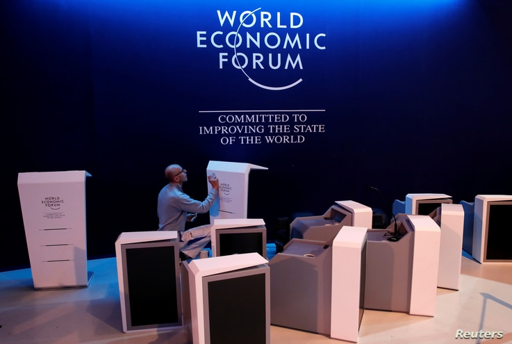 A staff checks elements of the stage ahead of the World Economic Forum (WEF) annual meeting in the Swiss Alps resort of Davos, Switzerland, Jan. 21, 2018