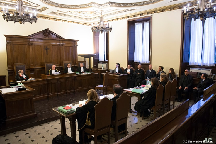 Italian journalists Gianluigi Nuzzi and Emiliano Fittipaldi (background, center) and Vatican officials are seen on the defendants' bench at their trial inside the Vatican, Nov. 24, 2015.